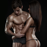 sexy couple, muscular man holding a beautiful woman isolated on